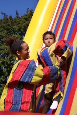 Family Weekend guest enjoying inflatables